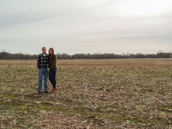 Alex and Brook Moore standing in their new field that they bought through MARBIDCO