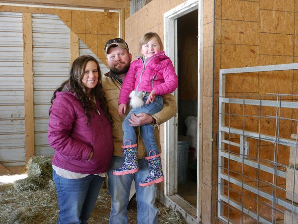 The Stephens family standing in their barn