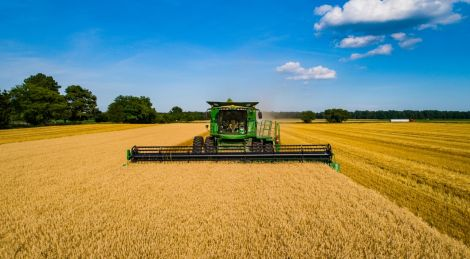 What is Crop Insurance? wheat harvest john deere tractor