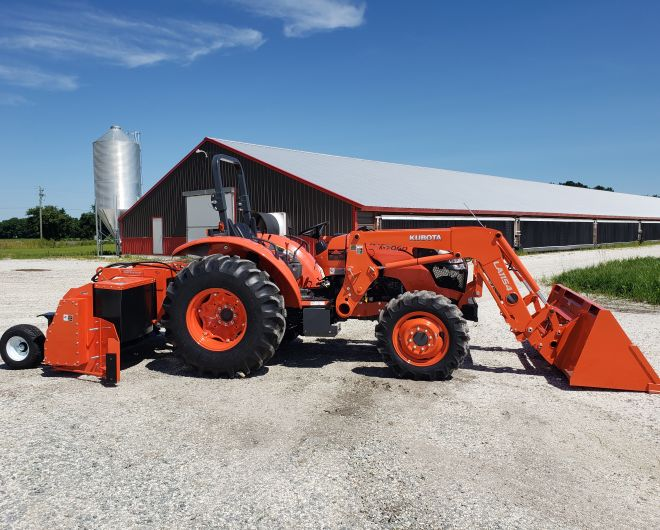 red kubota tractor and loader