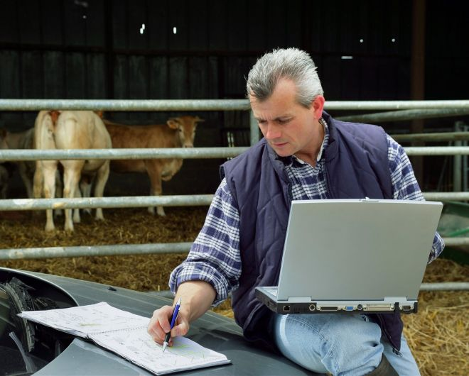 Farmer on laptop